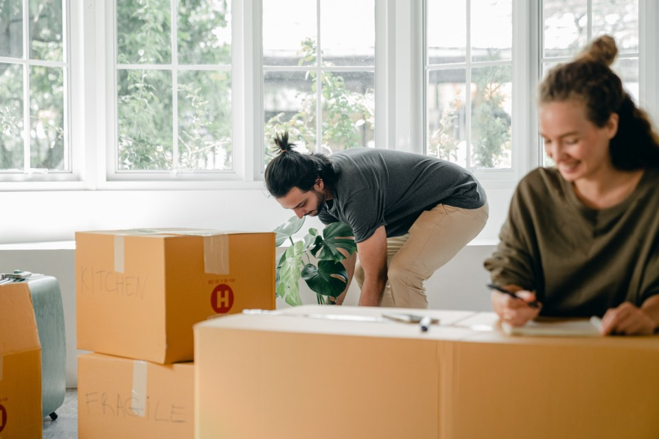 Happy young couple among boxes at new home 4246186